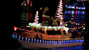 Boat decorated with Christmas lights in Holiday Activities